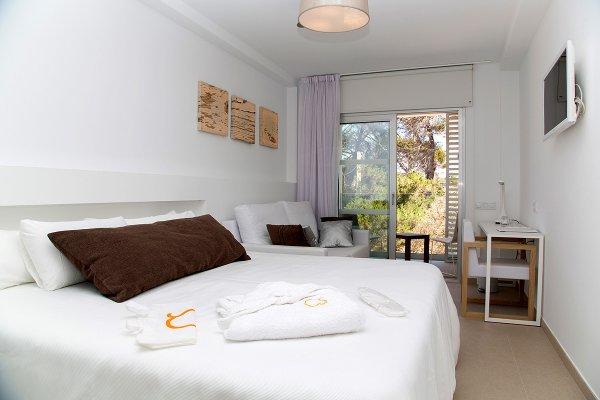 Chambre familiale avec lit bébé et accès au Spa